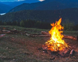 bonfire surrounded with green grass field